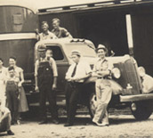 group in front of truck and train car 1937